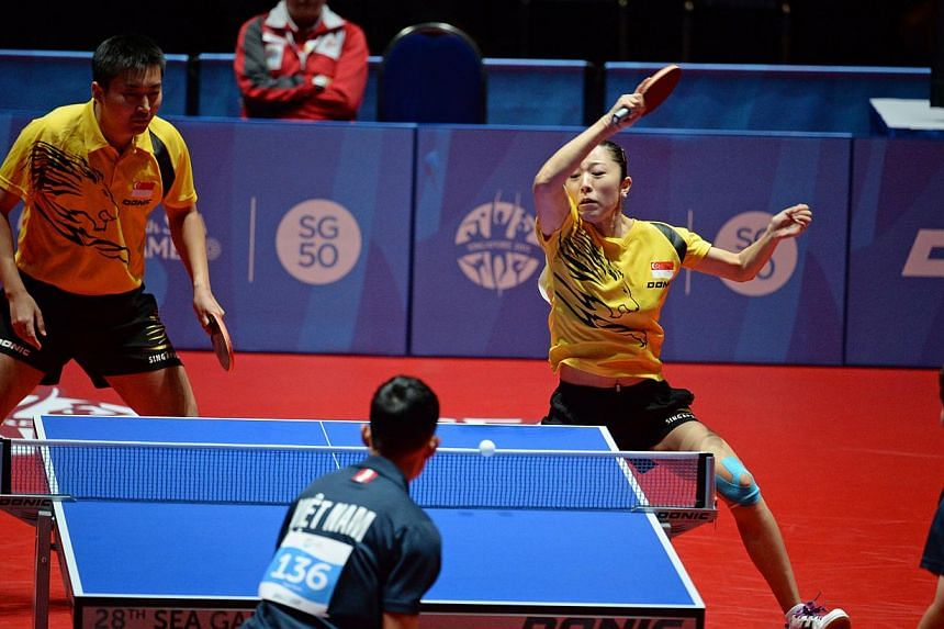 Singapore's Yu Mengyu and Yang Zi ( left ) playing against Vietnam in the semi final of the mixed doubles. -- ST PHOTO: DESMOND FOO