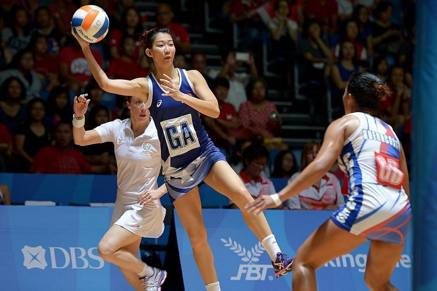 Singapore's netballers cruised into the SEA Games semi-finals with a 84-12 win over the Philippines. -- ST PHOTO: DESMOND WEE