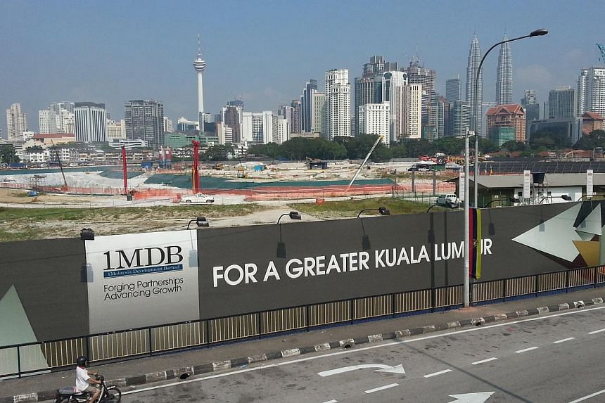 """Malaysia's central bank said on Wednesday it had launched a """"formal inquiry"""" into strategic development fund 1Malaysia Development Bhd (1MDB), which is struggling under a huge debt burden and suspicions of massive fraud and mismanagement. -- PHOTO: S"""