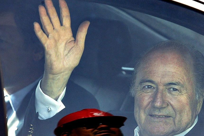 Sepp Blatter waves as he leaves the FNB stadium after visit to see the progress on the stadium in Soweto, South Africa for the WC2010 and the Confederation cup in a file photo taken in 2008. -- PHOTO: AFP