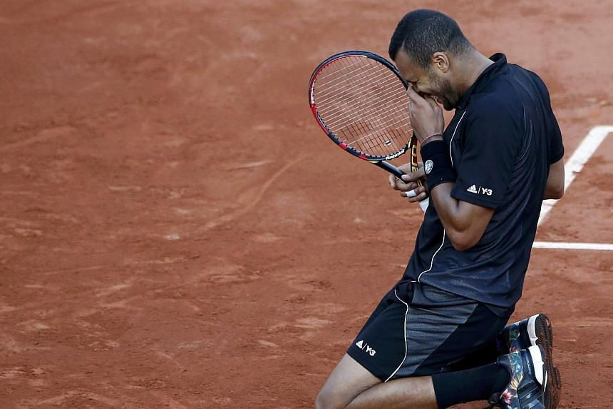 Jo-Wilfried Tsonga of France celebrates after defeating Kei Nishikori of Japan during their men's quarter-final match during the French Open tennis tournament at the Roland Garros stadium in Paris. PHOTO: REUTERS