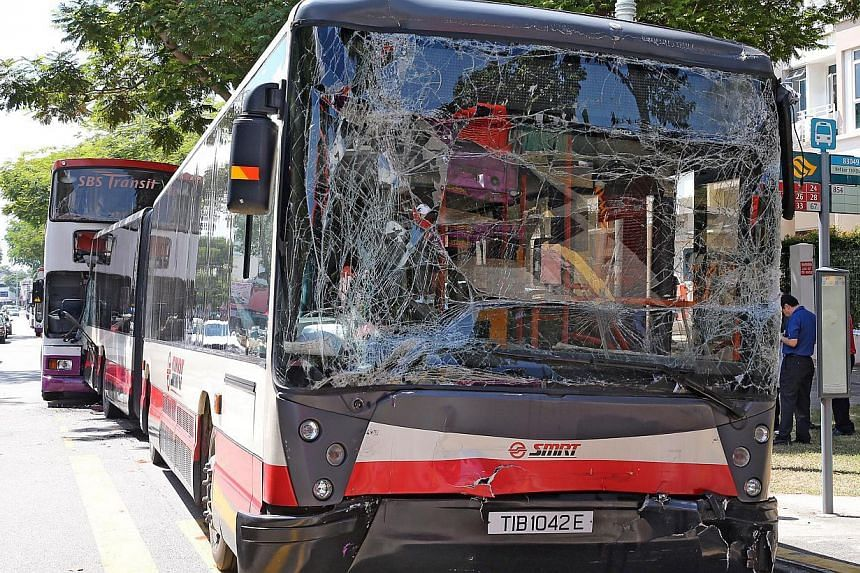 Twenty-eight people were injured in an accident involving three buses along Changi Road on Thursday morning. -- PHOTO: SHIN MIN
