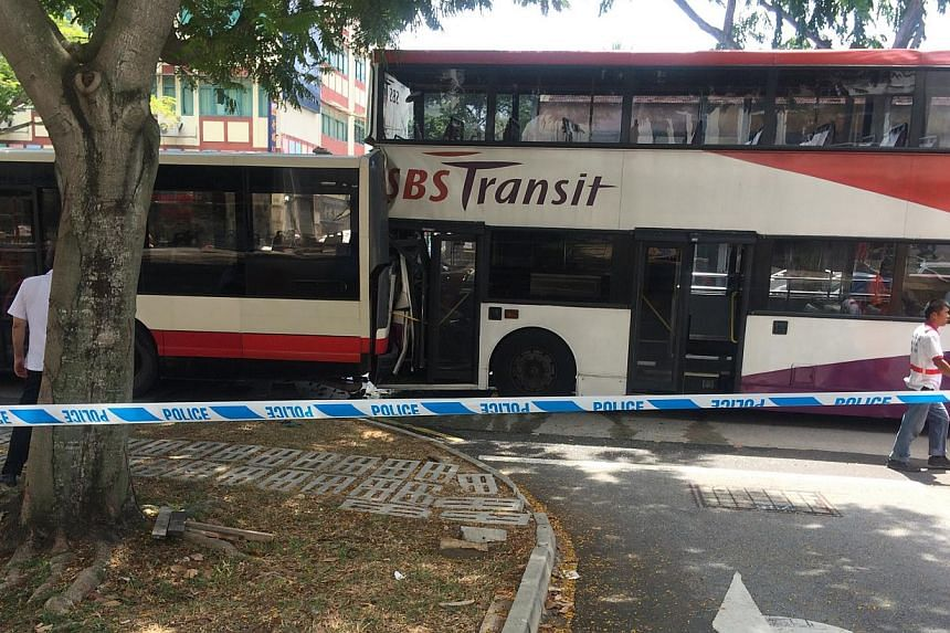 Twenty-eight people were injured in an accident involving three buses along Changi Road on Thursday morning. -- ST PHOTO: ONG KAI XUAN