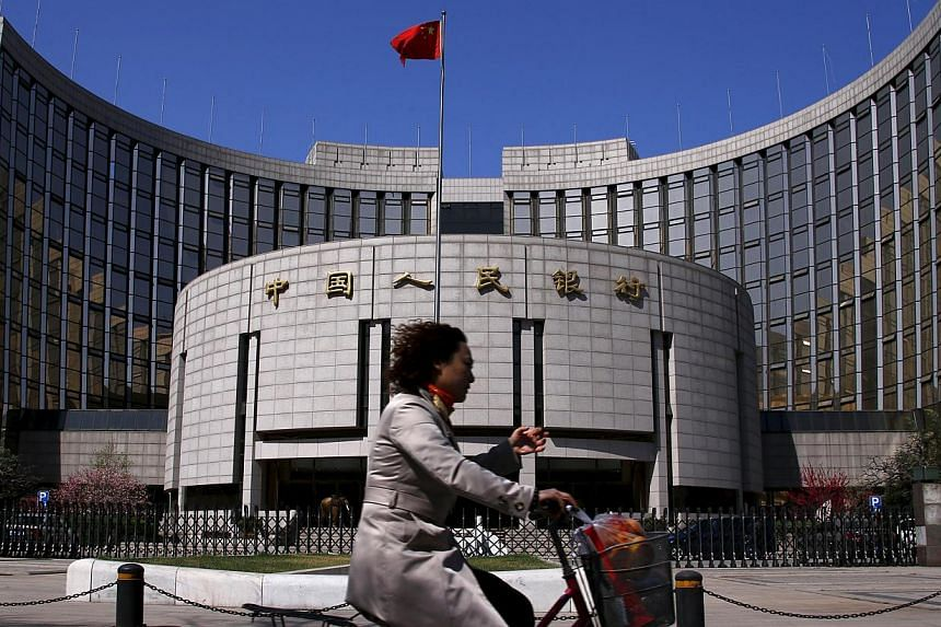China's central bank is likely to remove the ceiling on bank deposit rates soon, instead of raising the cap again, Sheng Songcheng, head of the statistics department at the People's Bank of China, was quoted on Thursday as saying. -- PHOTO: REUTERS
