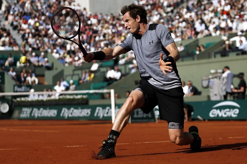 Andy Murray of Britain in action against David Ferrer of Spain during their quarterfinal match for the French Open tennis tournament at Roland Garros in Paris, France, on June 3, 2015. -- PHOTO: EPA