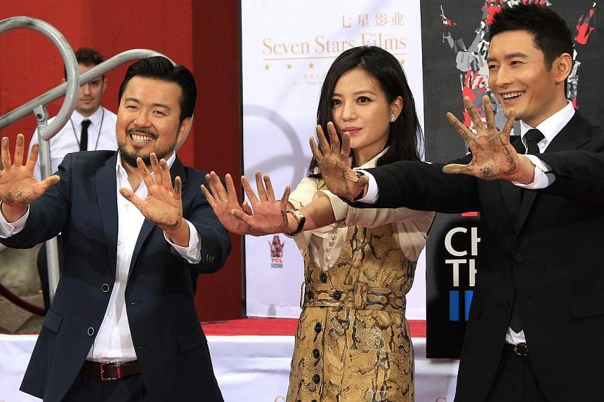 (From left) US director Justin Lin, Chinese actress Zhao Wei and Chinese actor Huang Xiaoming leaving their prints at the TCL Chinese Theatre in Hollywood, California, on June 3, 2015. -- PHOTO: EPA
