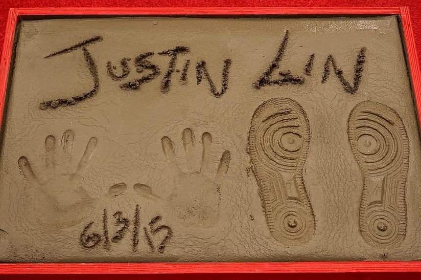 US director Justin Lin's prints at the TCL Chinese Theatre in Hollywood, California, on June 3, 2015.-- PHOTO: EPA