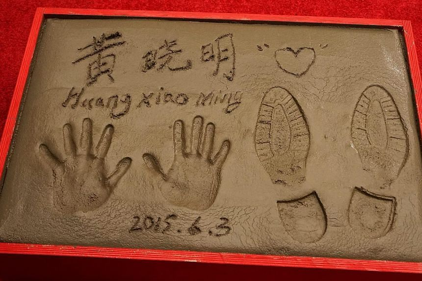 Chinese actor Huang Xiaoming's prints at the TCL Chinese Theatre in Hollywood, California, on June 3, 2015.-- PHOTO: EPA