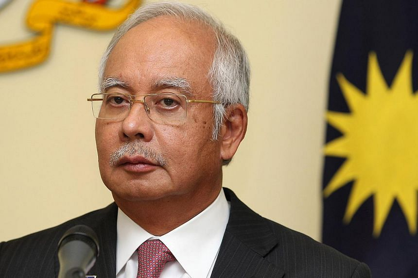 Prime Minister Datuk Seri Najib Razak is set to answer questions at an open townhall dialogue at the Putra World Trade Centre on Friday. -- PHOTO: BLOOMBERG