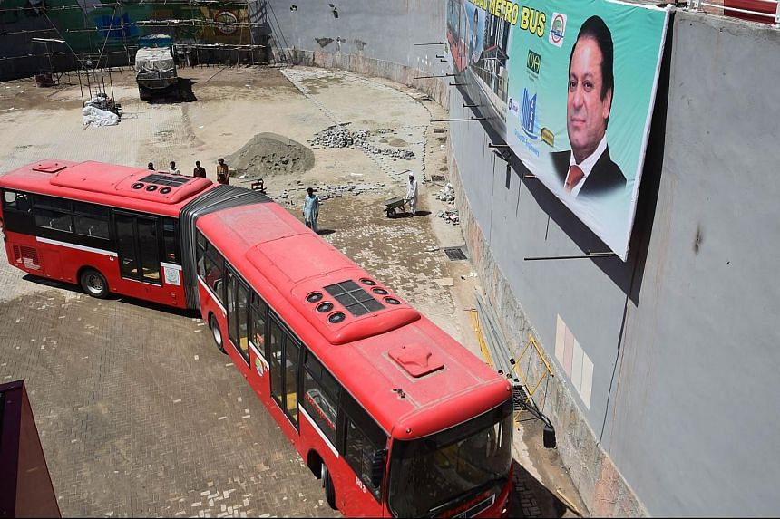 Pakistani Prime Minister Nawaz Sharif is due to open Islamabad's new half-billion dollar metrobus system on Thursday, which the government hopes will revolutionise transport in the capital but which has been criticised by some as extravagant. -- PHOT