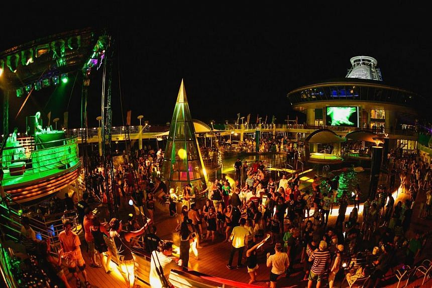 Partygoers having a wild time at the It's The Ship event (above) in November last year. The Costa Victoria cruise liner (below), which will be holding Shipsomnia.