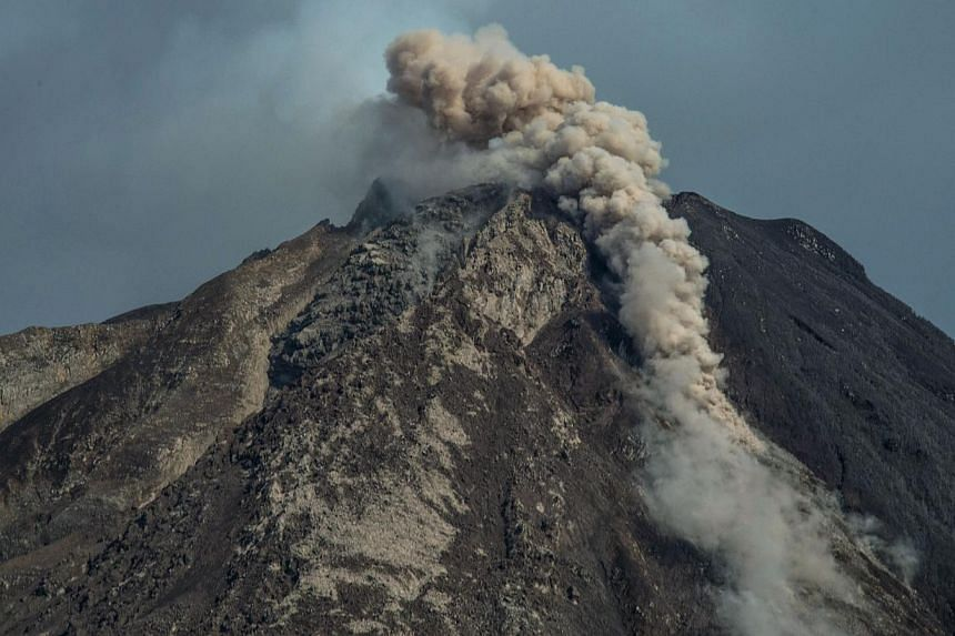 Mount Sinabung spews smoke and ash as seen from Karo district on Jun 3, 2015. Nearly 3,000 people have been evacuated from their homes after Indonesia upgraded the threat posed by a volcano on Sumatra to the highest possible level, an official said o