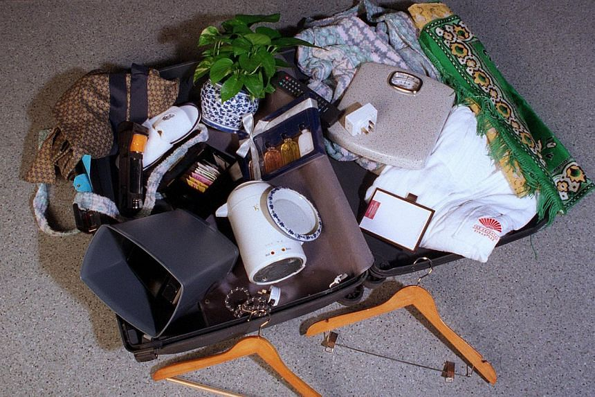 Singapore travellers are prone to taking items from hotel rooms, according to a survey by travel search website Hotels.com. -- PHOTO: ST FILE