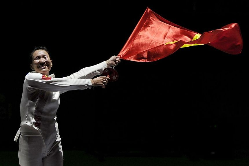 Vietnam's Tran Thi Len celebrates winning the womens individual Epee final, beating Harlene Raguin from the Philippines 11-7. -- PHOTO: REUTERS