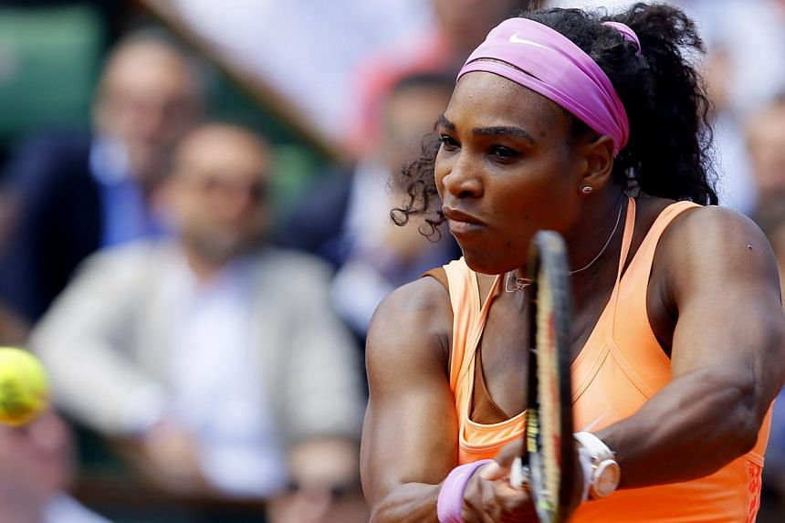 Serena Williams of the USA in action against.Sara Errani of Italy during their quarterfinal match for the French Open tennis tournament at Roland Garros in Paris, France on June 3, 2015. -- PHOTO: EPA