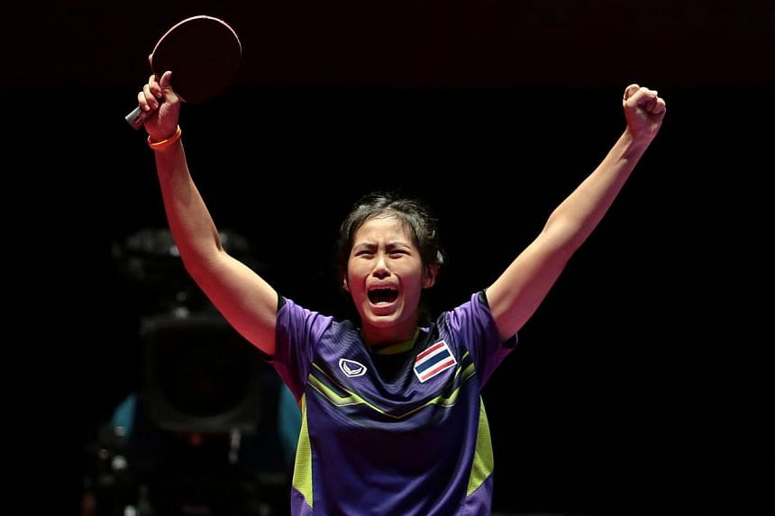 Thailand's Suthasini Sawettabut reacts after beating Malaysia's Ng Sock Khim 4-3 in the SEA Games table tennis women's singles final at the Singapore Indoor Stadium on Thursday night. -- PHOTO: REUTERS