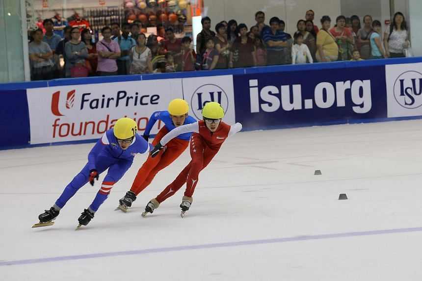 (left to right) Malaysia's Wong De Vin, Mongolia's Demchigsuren Dembereldavga and Singapore's Matthew Mak competing in the Junior age group for short track speed skating at the 2013 ISU World Development Trophy held at The Rink at JCube.  -- PHO