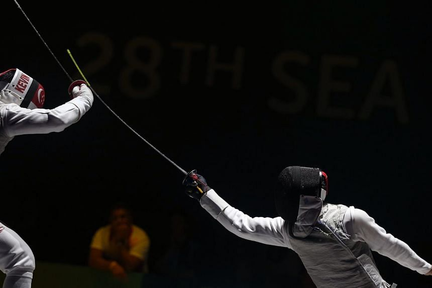 Thailand's Panchan Nontapat (right) beats Singapore's Kevin Jerrold Chan 15-6 in the SEA Games fencing men's individual foil semifinals held at the OCBC Arena Hall 2 on June 4, 2015. -- ST PHOTO: NEO XIAOBIN