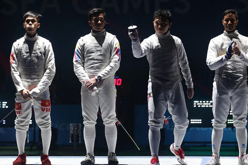 Semifinalists of the men's individual foil event. (From left) Vietnam's Nguyen Minh Quang, Philippines' Nathaniel Perez, Singapore's Kevin Jerrold Chan, and Thailand's Panchan Nontapat.-- ST PHOTO: NEO XIAOBIN