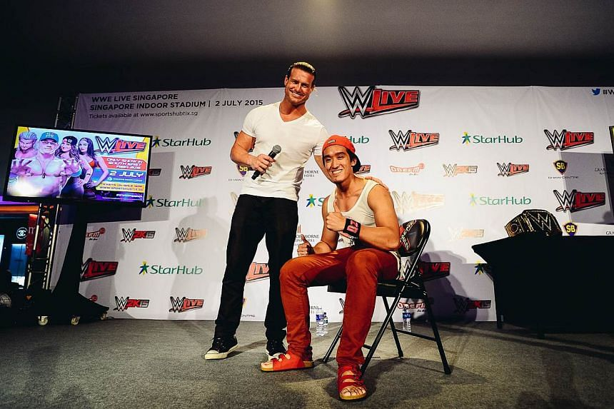 WWE Superstar Dolph Ziggler with the lucky StarHub winner who scored an autographed WWE Extreme Rules chair at Shaw House on May 28, 2015. -- PHOTO: WWE