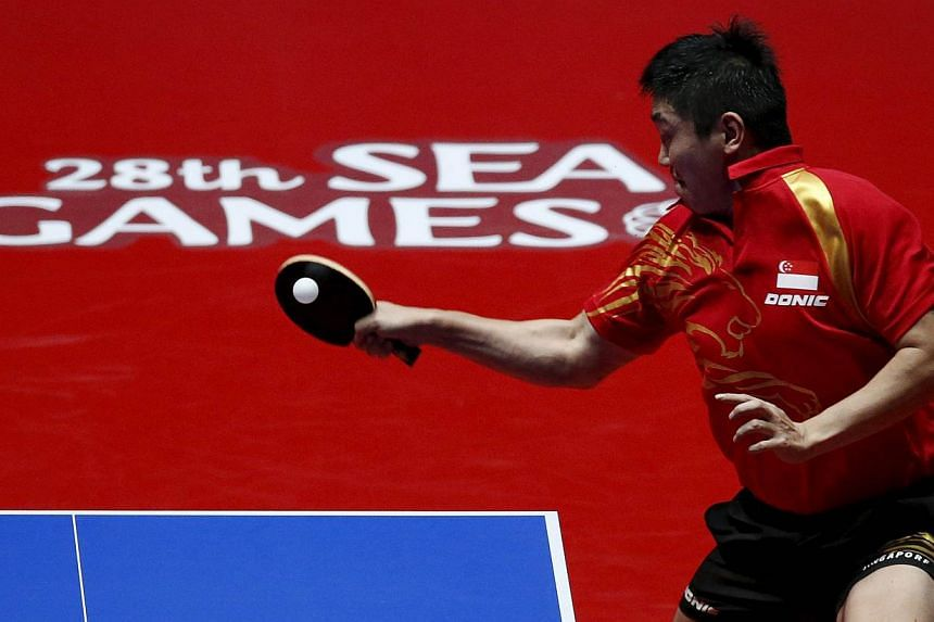 Singapore's Gao Ning hits a return to Richard Gonzales of the Philippines during their men's singles table tennis finals match at the Southeast Asian (SEA) Games in Singapore on June 4, 2015. -- PHOTO: REUTERS