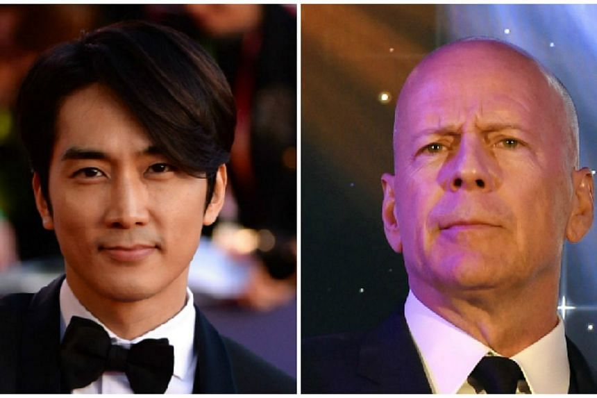 Korean star Song Seung Heon (left) has been cast in a Chinese war film, in which he will star opposite American actor Bruce Willis, his agency confirmed on Wednesday. -- PHOTOS: AFP
