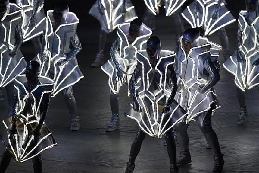 Dancers perform during the opening ceremony of the 28th SEA Games at the National Stadium on June 5, 2015. -- PHOTO: AFP