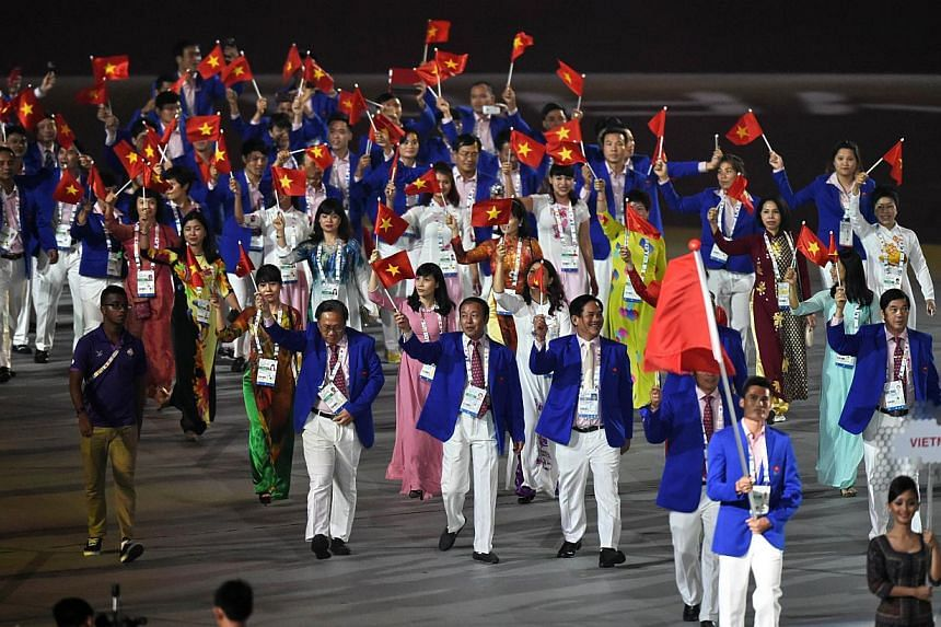 Athletes from Vietnam march during at the opening ceremony of the 28th SEA Games at the National Stadium on June 5, 2015. -- PHOTO: AFP