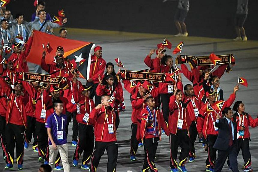 Athletes from East Timor march during at the opening ceremony of the 28th SEA Games at the National Stadium on June 5, 2015.  -- PHOTO: AFP