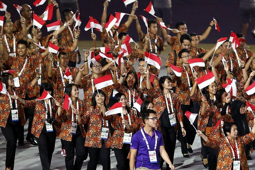 Athletes of Indonesia parade during the opening ceremony of the 28th SEA Games at the National Stadium on June 5, 2015. -- PHOTO: EPA
