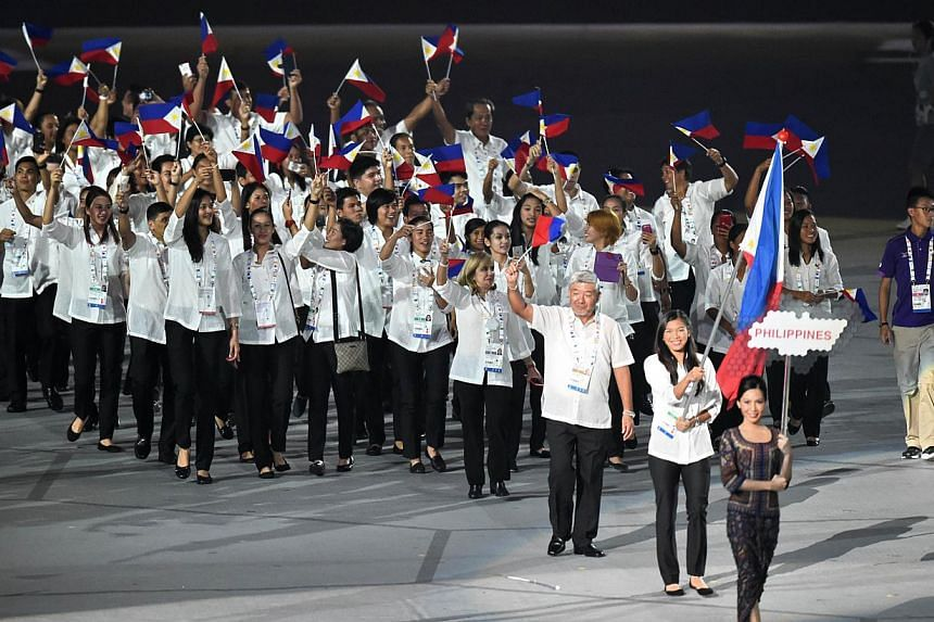 Athletes from the Philippines march during at the opening ceremony of the 28th SEA Games at the National Stadium on June 5, 2015. -- PHOTO: AFP