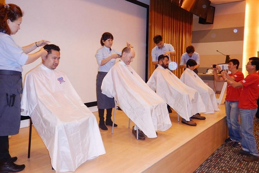 (From left) Mr Khairul Akram, Mr Timothy Goodchild, Mr Poo Chun Yong and Ms Cheong Sook Han take part in the Children's Cancer Foundation's (CCF) Hair for Hope effort on June 5, 2015. -- PHOTO: STARHUB