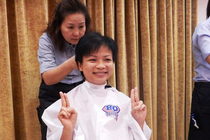 StarHub staff Terasa Choong preparing to shave her head at the Children's Cancer Foundation's (CCF) Hair for Hope effort on June 5, 2015. -- PHOTO: STARHUB