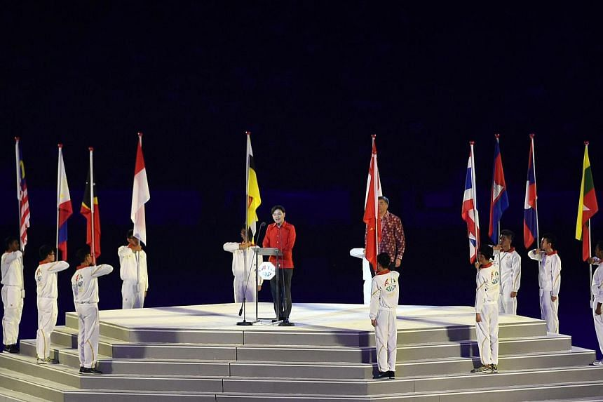 Singapore's Minister for Culture, Community and Youth, Lawrence Wong (centre, podium), delivers a speech at the opening ceremony of the 28th SEA Games at the National Stadium on June 5, 2015. -- PHOTO: AFP