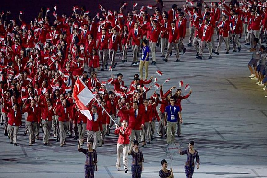 Athletes from Singapore march during at the opening ceremony of the 28th SEA Games at the National Stadium on June 5, 2015.-- ST PHOTO: DESMOND FOO