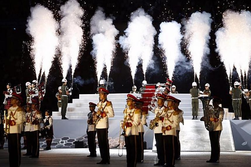 A combined band performance during the 28th SEA Games opening ceremony at the National Stadium on June 5, 2015. -- ST PHOTO: KEVIN LIM