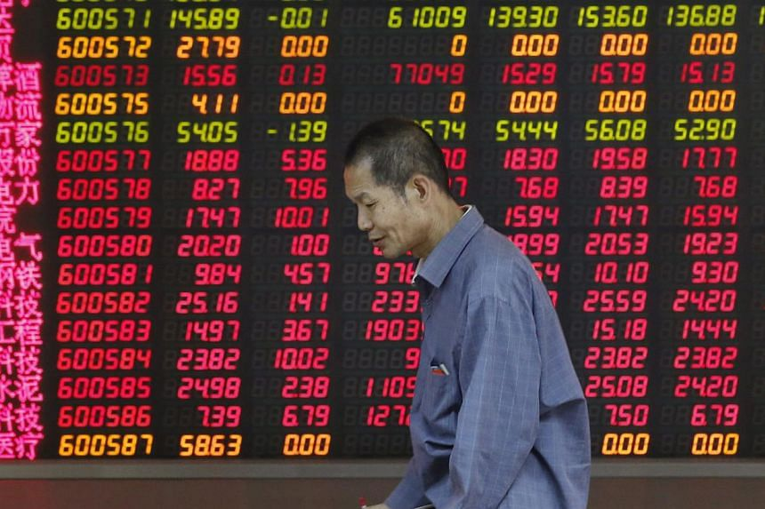 The Shanghai Composite Index climbed above 5,000 points for the first time in seven years, the latest milestone in a world-beating rally. -- PHOTO: EPA