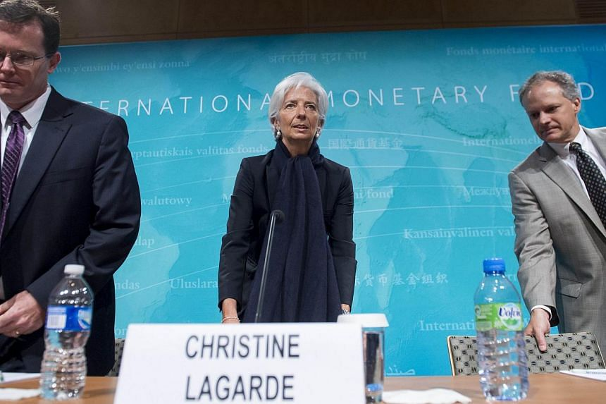 US Mission Chief Nigel Chalk (left), IMF Managing Director Christine Lagarde (centre) and Western Hemisphere Director Alejandro Werner at a press conference at IMF Headquarters in Washington, DC, on June 4, 2015. -- PHOTO: AFP
