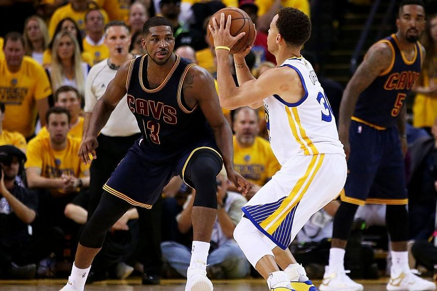 Stephen Curry of the Golden State Warriors shooting against Tristan Thompson #13 of the Cleveland Cavaliers in the second half during Game One of the 2015 NBA Finals on June 4, 2015, in Oakland, California. -- PHOTO: AFP