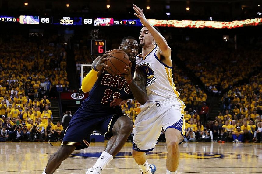 LeBron James of the Cleveland Cavaliers driving against Klay Thompson #11 of the Golden State Warriors in the third quarter during Game One of the 2015 NBA Finals on June 4, 2015, in Oakland, California. -- PHOTO: AFP