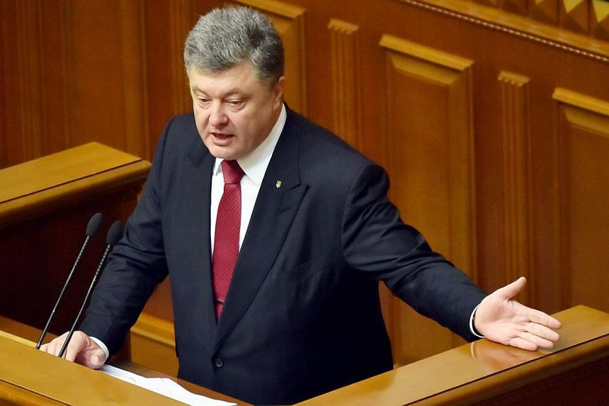 Ukrainian President Petro Poroshenko gesturing as he delivers his speech to deputies during his annual address to Parliament in Kiev on June 4, 2015. -- PHOTO: AFP