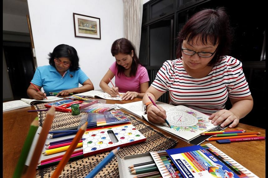 Calligraphy students (above) learn the basics, including how to use a pen to form letters. Friends and colouring hobbyists (from left) Jennifer Vas, Ana Jean Gonot and Olivia Ho, all aged 39.