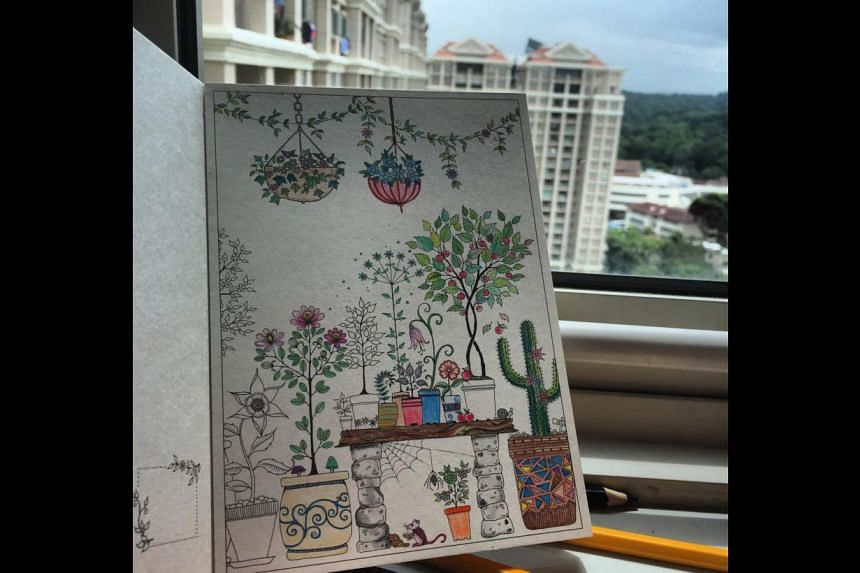 Pages of Johanna Basford's colouring book Secret Garden (above), coloured in by hobbyist Christine Leong, and calligraphy (right) done during a workshop.
