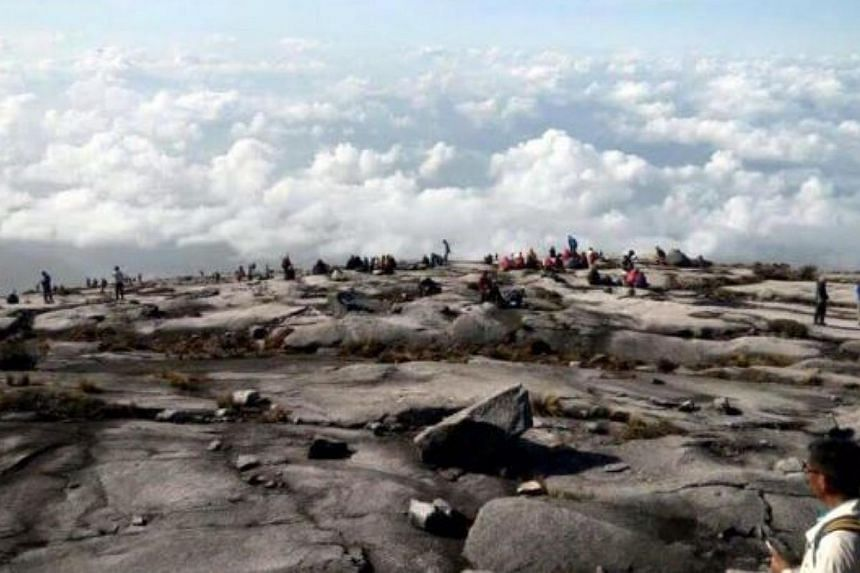 Climbers at the peak of Mount Kinabalu. -- PHOTO: COURTESY OF BOMBA MALAYSIA/ THE STAR/ ASIA NEWS NETWORK
