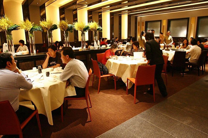 The interior of Imperial Treasure Super Peking Duck at Paragon. Navis Capital Partners will pay $60 million to $80 million for a majority stake in Imperial Treasure Restaurant Group. -- PHOTO: ST FILE