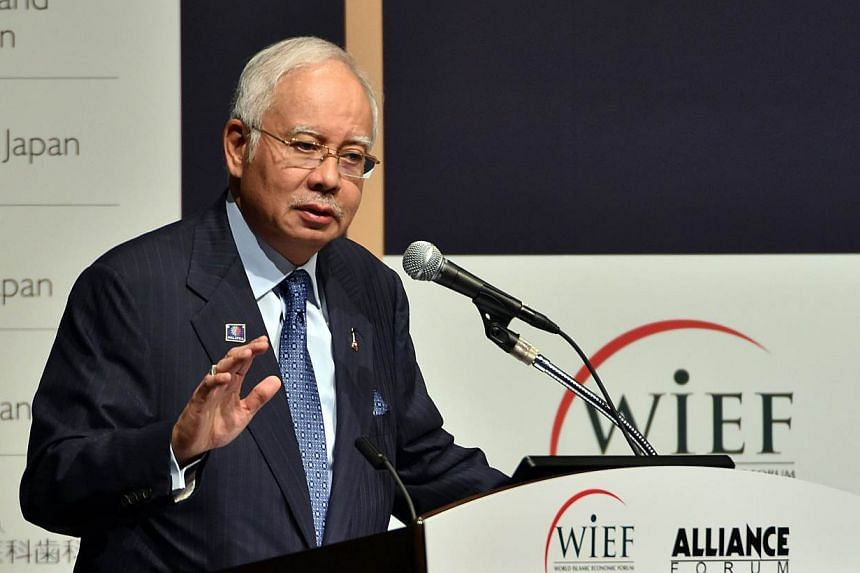 Malaysian Prime Minister Najib Razak delivers an opening speech for the round table meeting of the World Islamic Economic Forum (WIEF) Foundation and Alliance Forum Foundation (AFF) in Tokyo on May 26, 2015. -- PHOTO: AFP