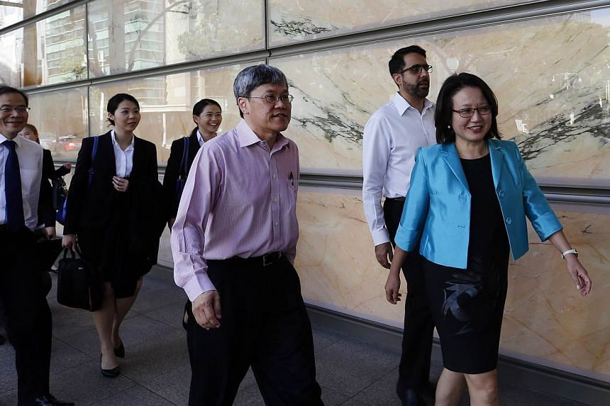 """WP chairman Sylvia Lim (right) together with her team walking into the supreme court on June 4, 2015. In a statement on Thursday, MND had said AHPETC was in urgent need of the grants, but had """"consistently resisted"""" the ministry's offer to disburse h"""