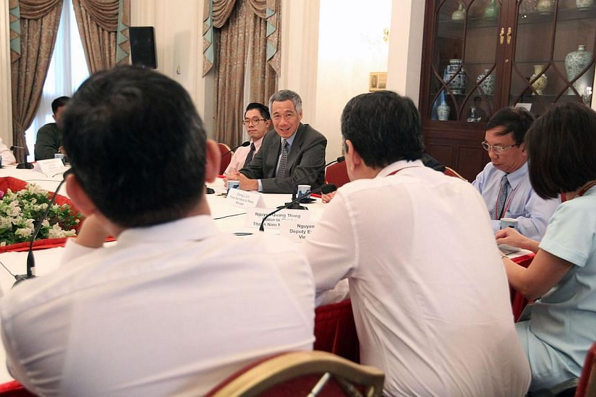 PM Lee speaking to the Asean journalists during the interview at the Istana on June 4, 2015. -- PHOTO: MCI
