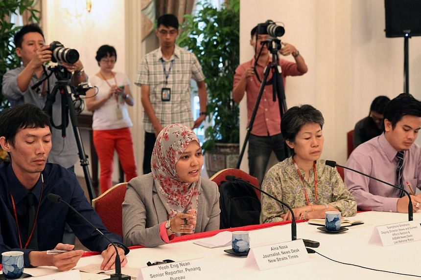 The visiting Asean journalists responding to PM Lee during their interview with him at the Istana on June 4, 2015. -- PHOTO: MCI