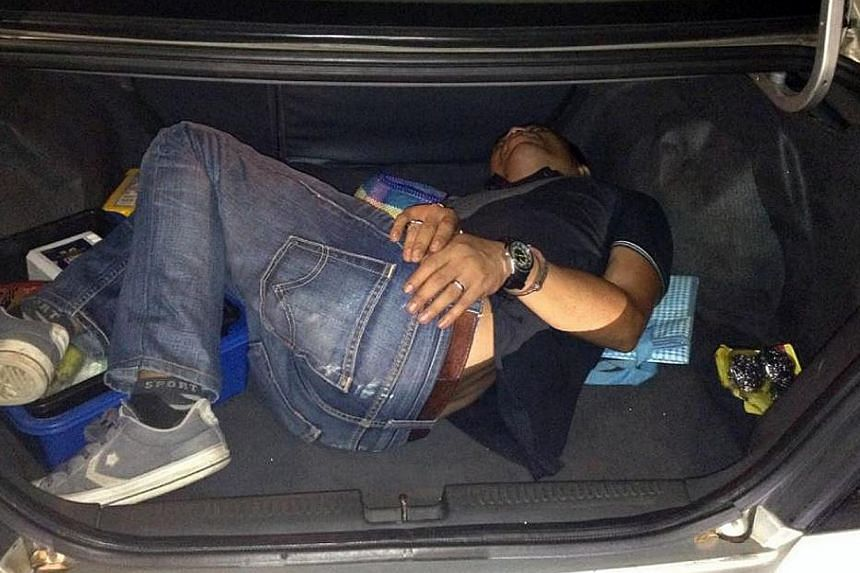 ICA officers found Sofyan in the boot of the Malaysian-registered car driven by Hasan when they checked the car. -- PHOTO: IMMIGRATION AND CHECKPOINTS AUTHORITY